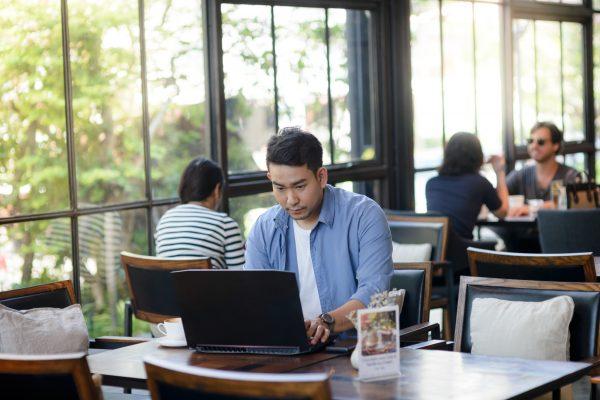 Asian Man Working With Laptop In Cafe, Work Concept.